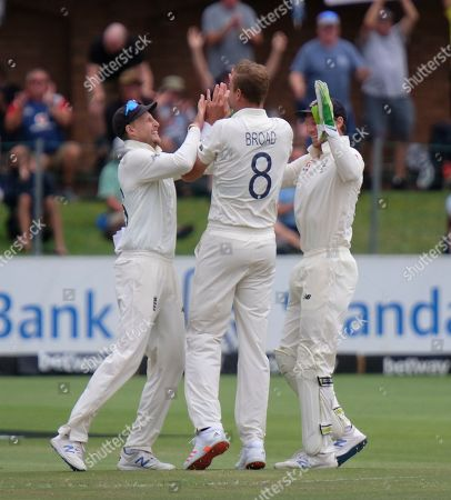 Stock Picture of England's wicketkeeper Jos Buttler, right, Stuart Board, center, and Joe Root celebrate the wicket of South Africa's Vernon Philander during day five of the third cricket test between South Africa and England in Port Elizabeth, South Africa