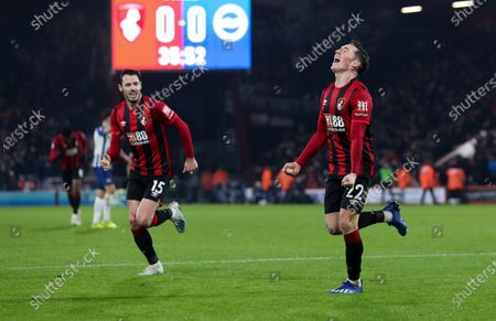 Harry Wilson of Bournemouth scores the opening goal of the game and celebrates with Adam Smith of Bournemouth (L)