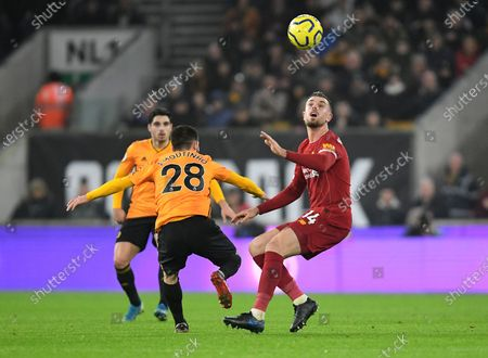 Jordan Henderson of Liverpool and Joao Moutinho of Wolverhampton Wanderers