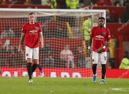 Phil Jones of Manchester United and Fred look dejected after the 1st goal