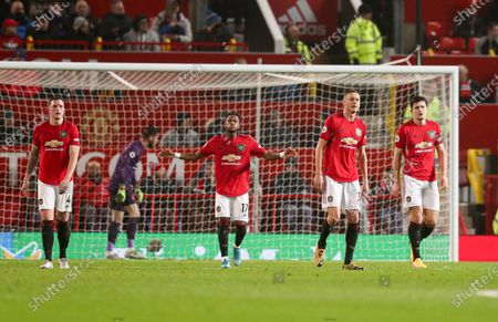 Nemanja Matic of Manchester United, Fred, Phil Jones and Harry Maguire look dejected after the 1st goal