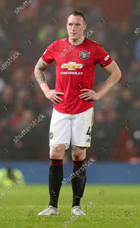 Phil Jones of Manchester United spits in frustration