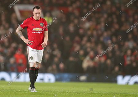 Phil Jones of Manchester United looks dejected during the game