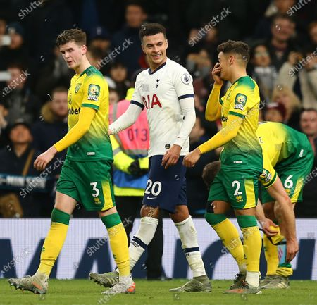 Dele Alli of Tottenham Hotspur  jokes with Maximillian Aarons of Norwich City after the match
