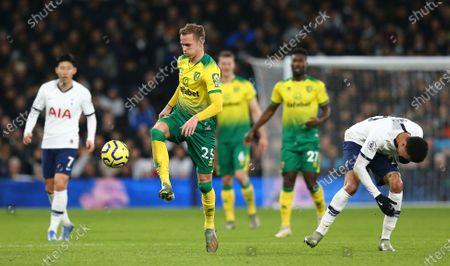 Dele Alli of Tottenham Hotspur appears to get a slap from Ondrej Duda of Norwich