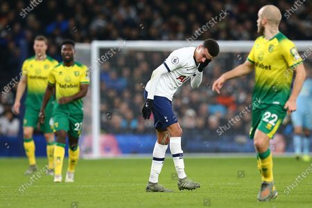 Dele Alli of Tottenham Hotspur after collision with Ondrej Duda of Norwich