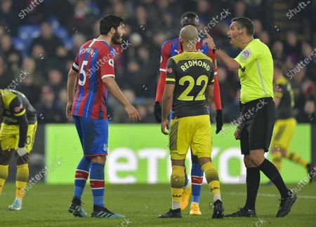 James Tomkins of Crystal Palace questions Andre Marriner match referee