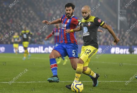 Nathan Redmond of Southampton under pressure from James Tomkins of Crystal Palace