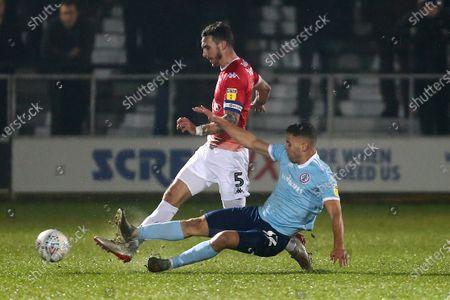 Accrington's Dion Charles tackles Liam Hogan of Salford City