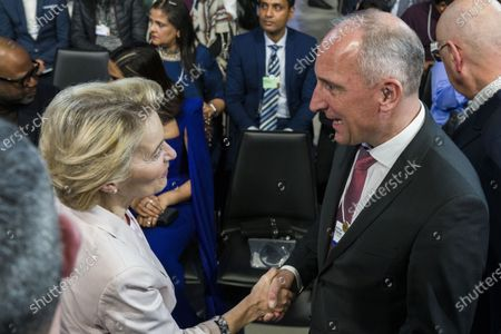 Stock Image of Adrian Hasler, Prime Minister of the Principality of Liechtenstein, right, shakes hands with Ursula von der Leyen, president of the European Commission, ahead of the opening session of the 50th annual meeting of the World Economic Forum, WEF, in Davos,, Switzerland, 20 January 2020. The meeting brings together entrepreneurs, scientists, corporate and political leaders in Davos from January 21 to 24.