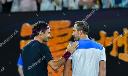 Roger Federer of Switzerland and Steve Johnson of the United States after their men's singles first round match