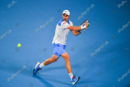 Steve Johnson of the United States hits a return during her women's singles first round match