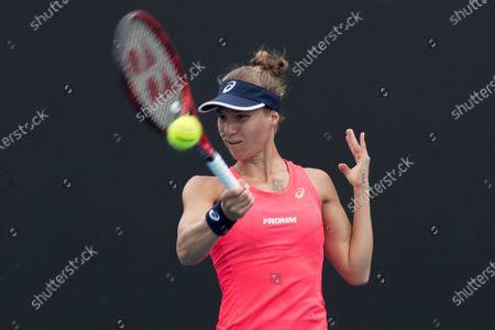 Viktorija Golubic of Switzerland hits a return during her women's singles first round match