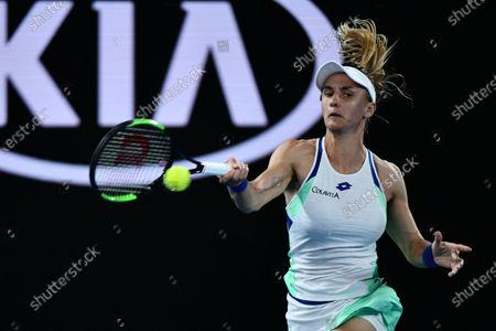 Lesia Tsurenko of Ukraine returns a shot during her women's singles first round match