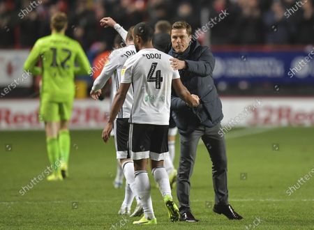 Scott Parker manager of Fulham shakes hands with Denis Odoi of Fulham at the final whistle