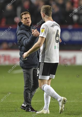 Scott Parker manager of Fulham shakes hands with Kevin McDonald of Fulham