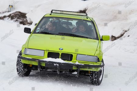 Chloe Jouannet and Sabrina Ouazani drive a car on the ice race track