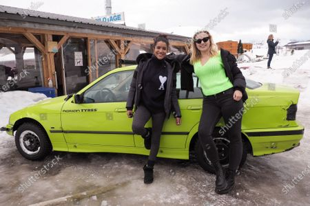 Chloe Jouannet and Sabrina Ouazani pose with a car on the ice race track