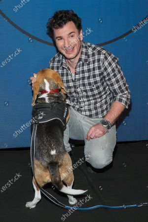 Michael Youn and the dog Lucky attend the 'Lucky' photocall