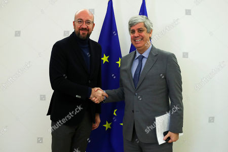 Charles Michel, Mario Centeno. European Council President Charles Michel, left, shakes hands with Eurogroup President Mario Centeno before their meeting at the Europa building in Brussels