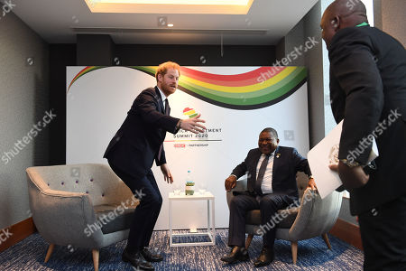 Prince Harry meets Filipe Nyusi, President of Mozambique (seated) at the Intercontinental Hotel