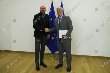 European Council President Charles Michel (L) welcomes Eurogroup President Mario Centeno before their meeting at the Europa building in Brussels, Belgium 20 January 2020.