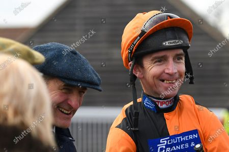 Jockey Leighton Aspell right shares a joke with trainer Richard Rowe during Horse Racing at Plumpton Racecourse on 20th January 2020