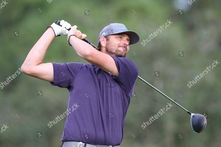 Champions LPGA Golf. Mardy Fish, former American professional tennis player, drives from the 17th tee during the final round of the Tournament of Champions LPGA golf tournament, in Lake Buena Vista, Fla