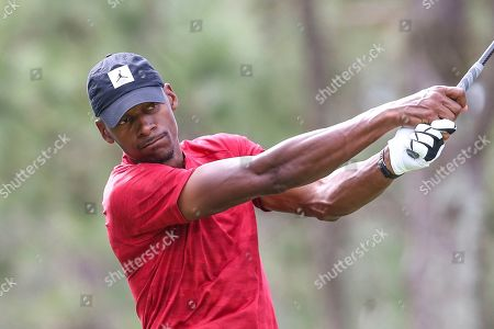 Stock Image of Champions LPGA Golf. Ray Allen, former professional basketball player, drives from the 2nd tee during during the final round of the Tournament of Champions LPGA golf tournament, in Lake Buena Vista, Fla