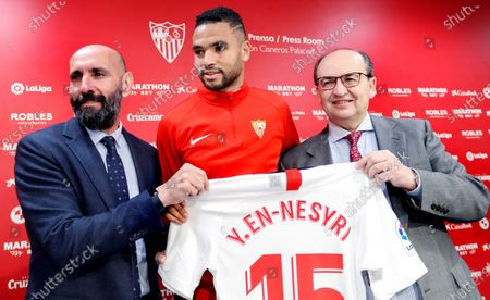 Morrocan striker Youssef En-Nesyri (C) during his presentacion next to Sevilla FC's President Jose Castro (R) and Sports manager Ramon Rodriguez 'Monchi' (L) held in Seville, Andalusia, Spain on 20 January 2020. En-Nesyri has been transfered from Leganes for 20 million Euro.