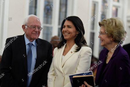 Bernie Sanders, Tulsi Gabbard, Elizabeth Warren. US. Sen. Bernie Sanders, left, I-Vt., U.S. Rep. Tulsi Gabbard, center, D-Hawaii, and Sen. Elizabeth Warren, right, D--Mass., speak at a Martin Luther King Jr. Day services at Zion Baptist Church, in Columbia, S.C