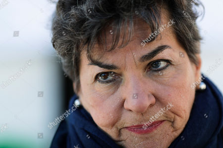 Christiana Figueres listens to questions during an interview with the Associated Press prior to a news conference of ?The Unite Behind The Science' campaign ahead of the World Economic Forum in Davos, Switzerland, . The 50th annual meeting of the forum will take place in Davos from Jan. 21 until Jan. 24, 2020