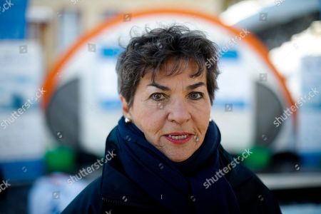 Christiana Figueres poses for a photo after an interview with the Associated Press prior to a news conference of ?The Unite Behind The Science' campaign ahead of the World Economic Forum in Davos, Switzerland, . The 50th annual meeting of the forum will take place in Davos from Jan. 21 until Jan. 24, 2020