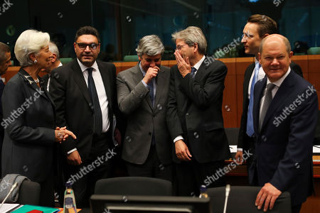 Christine Lagarde, Constantinos Petrides, Mario Centeno, Paolo Gentiloni, Gernot Blumel, Olaf Scholz. European Central Bank President Christine Lagarde, Cyprus' Economy Minister Constantinos Petrides, Eurogroup President Mario Centeno, European Commissioner for Economy Paolo Gentiloni, Austrian Finance Minister Gernot Blumel and German Finance Minister Olaf Scholz, from left, talk each other during a meeting of European Union Finance Ministers in Eurogroup format at the Europa building in Brussels