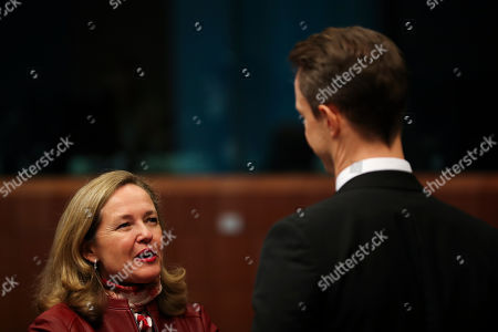 Nadia Calvino, Gernot Blumel. Spanish Economy Minister Nadia Calvino, left, talks to Austrian Finance Minister Gernot Blumel during a meeting of European Union Finance Ministers in Eurogroup format at the Europa building in Brussels