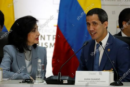The head of the National Assembly of Venezuela, Juan Guaido (R), talks with the Foreign Minister of Colombia, Claudia Blum (L), during the installation of the 3rd Hemispheric Ministerial Conference to Combat Terrorism, at the General Santander Police Cadet School, in Bogota, Colombia, 20 January 2020. The Conference is attended by ministers and vice ministers of Foreign Affairs, Government and delegates from Argentina, Bolivia, Brazil, Canada, Chile, Colombia, Costa Rica, Ecuador, El Salvador, United States, Guatemala, Haiti, Honduras, Mexico, Panama Paraguay , Peru, Dominican Republic, Saint Lucia and Uruguay. The meeting is also attended by representatives from Spain, Israel and Venezuela as observers.