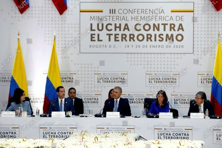 Stock Picture of The president of Colombia, Ivan Duque (C), speaks next to the head of the National Assembly of Venezuela, Juan Guaido (2L); the Foreign Minister of Colombia, Claudia Blum (L); the Colombian Vice President Marta Lucia Ramirez (2R), and the Colombian Defense Minister Carlos Holmes Trujillo (R), during the installation of the 3rd Hemispheric Ministerial Conference to Combat Terrorism, at the General Santander Police Cadet School, in Bogota, Colombia, 20 January 2020. The Conference is attended by ministers and vice ministers of Foreign Affairs, Government and delegates from Argentina, Bolivia, Brazil, Canada, Chile, Colombia, Costa Rica, Ecuador, El Salvador, United States, Guatemala, Haiti, Honduras, Mexico, Panama Paraguay , Peru, Dominican Republic, Saint Lucia and Uruguay. The meeting is also attended by representatives from Spain, Israel and Venezuela as observers.