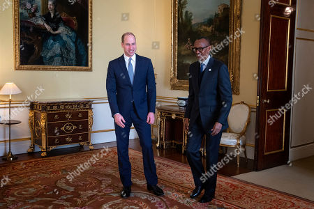 Prince William talks with the President of Rwanda, Paul Kagame, during an audience at Buckingham Palace