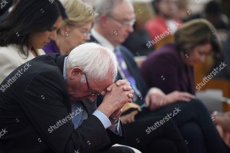 Tulsi Gabbard, Elizabeth Warren, Bernie Sanders, Amy Klobuchar. Democratic presidential candidate Bernie Sanders puts his head on his hands during a Martin Luther King Jr. Day prayer service, in Columbia, S.C