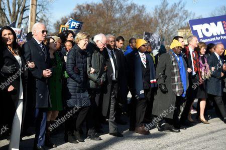 Tulsi Gabbard, Joe Biden, Amy Klobuchar, Elizabeth Warren, Bernie Sanders, Pete Buttigieg, Tom Steyer, Deval Patrick. Most of the Democrats seeking their party's presidential nomination march in a Martin Luther King Jr. Day rally, in Columbia, S.C