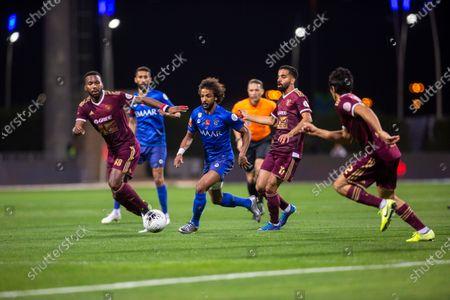 Stock Picture of AL- Faisaly's Khaleem Hyland (L) in action against Al-Hilal's Yasser al shahrani (C) And AL- Faisaly's Khaled Al-Ghamdi (R-2) and AL- Faisaly's Hussein Al- Qahtani (R-1) during the Saudi Professional League soccer match between Al-Faisaly and Al-Hilal at Al Majmaa City Stadium, Majmaa, Saudi Arabia, 20 January 2020.