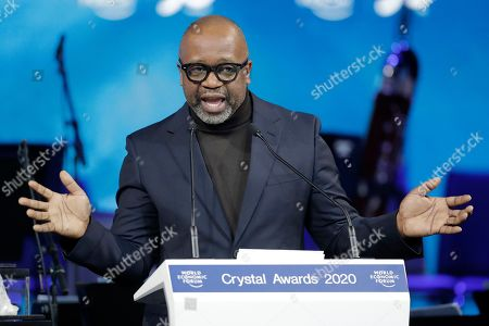 Artist Theaster Gates, from the United States, addresses the audience after receiving a Crystal Award from Hilde Schwab, Chairwoman and Co-Founder of the World Economic Forum's World Arts Forum, during the ceremony for the Crystal Awards at the annual meeting of the World Economic Forumin Davos, Switzerland, . The 50th annual meeting of the forum will take place in Davos from Jan. 21 until Jan. 24, 2020