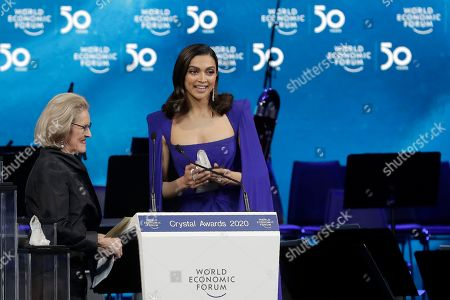 Actress Deepika Padukone, from India, receives a Crystal Award from Hilde Schwab, Chairwoman and Co-Founder of the World Economic Forum's World Arts Forum, during the ceremony for the Crystal Awards at the annual meeting of the World Economic Forumin Davos, Switzerland, . The 50th annual meeting of the forum will take place in Davos from Jan. 21 until Jan. 24, 2020