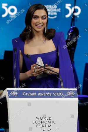 Actress Deepika Padukone, from India, smiles after receiving a Crystal Award from Hilde Schwab, Chairwoman and Co-Founder of the World Economic Forum's World Arts Forum, during the ceremony for the Crystal Awards at the annual meeting of the World Economic Forumin Davos, Switzerland, . The 50th annual meeting of the forum will take place in Davos from Jan. 21 until Jan. 24, 2020