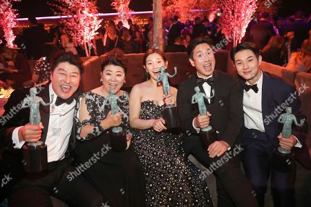 """Kang-Ho Song, Jang Hye-jin, Park So-dam, Lee Sun-kyun, Choi Woo-shik. IMAGE DISTRIBUTED FOR PEOPLE MAGAZINE - Kang-Ho Song, from left, Jang Hye-jin, Park So-dam, Lee Sun-kyun, and Choi Woo-shik, winners of the award for outstanding performance by a cast in a motion picture for """"Parasite"""" attend the 2020 PEOPLE SAG Awards Afterparty at the Shrine Auditorium & Expo Hall, in Los Angeles"""