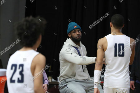 Los Angeles Lakers LeBron James congratulates Sierra Canyon players after their loss against against Paul VI in a high school basketball game at the Hoophall Classic, in Springfield, MA