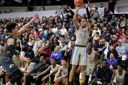 Stock Image of DeMatha's Jordan Hawkins #24 takes a jumper against Rancho Christian during a high school basketball game at the Hoophall Classic, in Springfield, MA