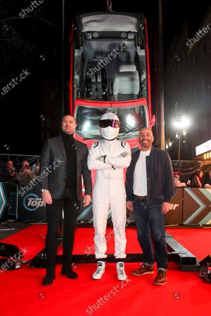 Top Gear presenters Paddy McGuinness and Chris Harris, with The Stig, by the Rover Metro Cabriolet that Andrew 'Freddie' Flintoff bungee-jumps off a Swiss dam during Episode 1