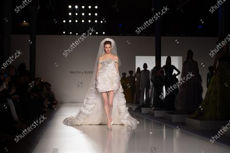 A model presents a bridal gown from the Spring/Summer 2020 Haute Couture collection of British designers Tamara Ralph and Michael Russo for their label Ralph and Russo during the Paris Fashion Week, in Paris, France, 20 January 2020. The presentation of the Haute Couture collections runs from 20 to 23 January.