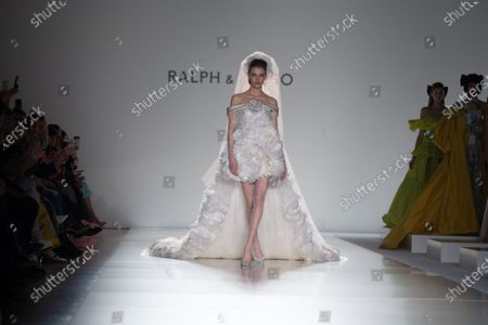 Stock Image of A model presents a bridal gown from the Spring/Summer 2020 Haute Couture collection of British designers Tamara Ralph and Michael Russo for their label Ralph and Russo during the Paris Fashion Week, in Paris, France, 20 January 2020. The presentation of the Haute Couture collections runs from 20 to 23 January.